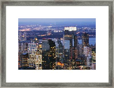 Manhattan Skyscrapers At Dusk Framed Print by Jeremy Woodhouse