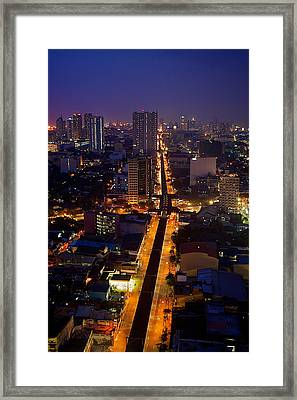 Manila City Framed Print by Arj Munoz