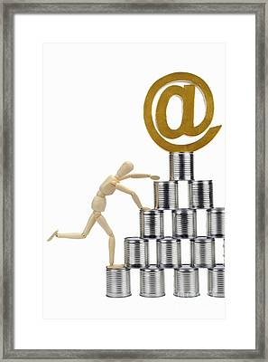 Mannequin Climbing Tin Cans Pyramid Framed Print by Sami Sarkis
