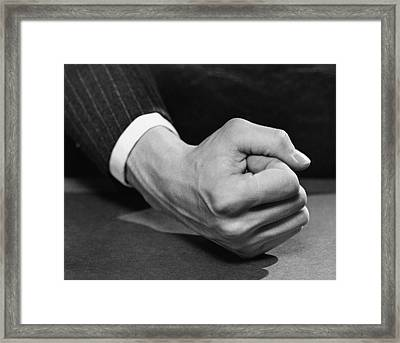 Man's Fist Framed Print by George Marks