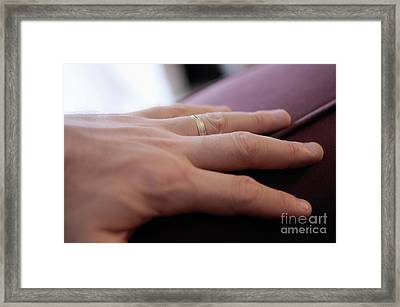 Man's Hand On Sofa With Wedding Ring Framed Print by Sami Sarkis