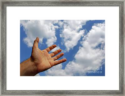 Mans Hand Reaching For Clouds Framed Print by Sami Sarkis