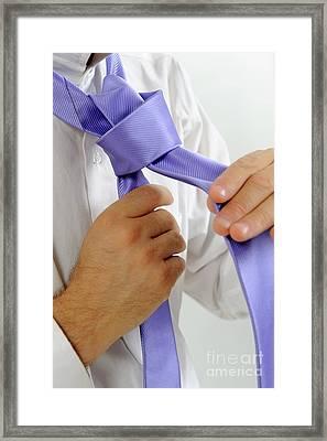 Man's Hands Adjusting Tie Framed Print by Sami Sarkis