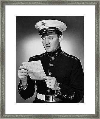 Marine Reading Letter Framed Print by George Marks