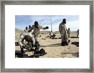 Marines And Sailors Assist Each Other Framed Print