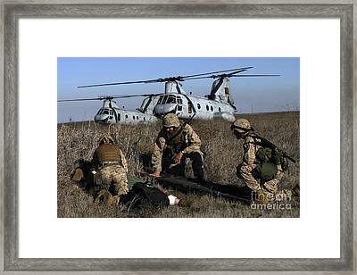 Marines And Sailors Being Transported Framed Print by Stocktrek Images