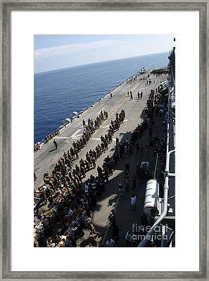 Marines And Sailors Gather Together Framed Print by Stocktrek Images