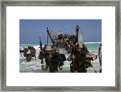 Marines Disembark A Landing Craft Framed Print by Stocktrek Images