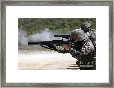 Marines Firing Shotguns Framed Print by Stocktrek Images