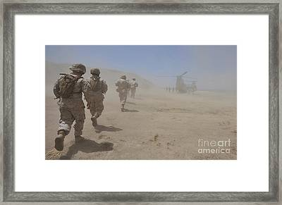 Marines Move Through A Dust Cloud Framed Print by Stocktrek Images