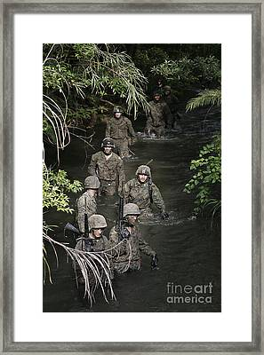 Marines Move To Their Next Obstacle Framed Print by Stocktrek Images