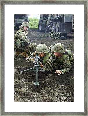 Marines Practice Setting Up An M240g Framed Print by Stocktrek Images