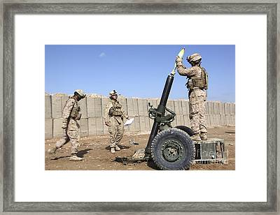 Marines Prepare To Fire A 120mm Mortar Framed Print by Stocktrek Images