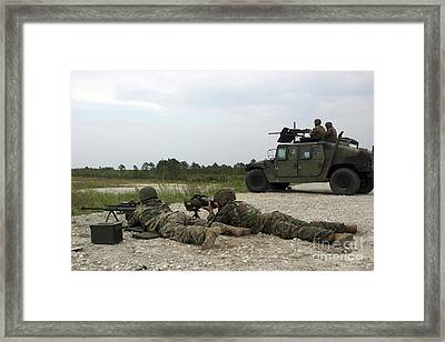 Marines Provide Support Fire On Targets Framed Print by Stocktrek Images