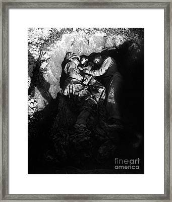 Marines Share A Foxhole With An Orphan Framed Print by Stocktrek Images