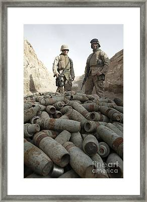 Marines Stand Over A Pile Of Unused Framed Print