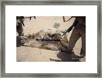 Marines Stand Over A Rocket-propelled Framed Print