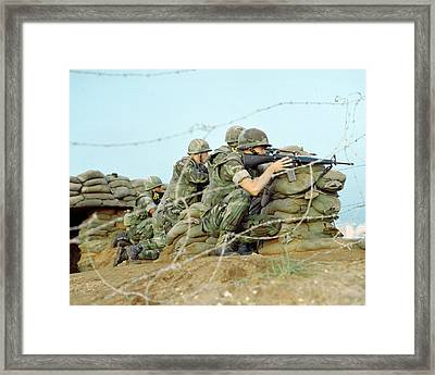 Marines Take Cover Behind Sandbags Framed Print