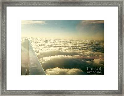 Marshmallow Clouds Framed Print