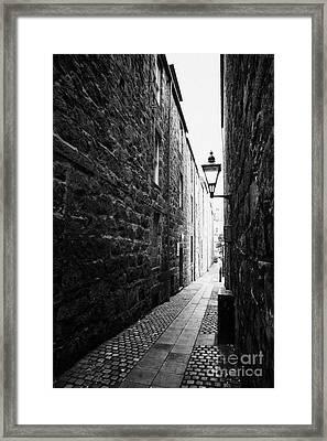 Martins Lane Narrow Entrance To Tenement Buildings In Old Aberdeen Scotland Uk Framed Print by Joe Fox
