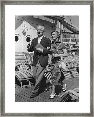Mature Couple On Deck Of Boat Framed Print by George Marks