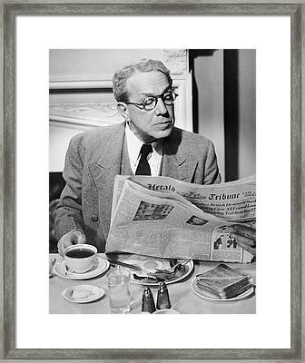 Mature Man Breakfasting & Reading Paper Framed Print by George Marks