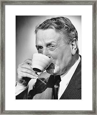 Mature Man Drinking Cup Of Coffee Framed Print