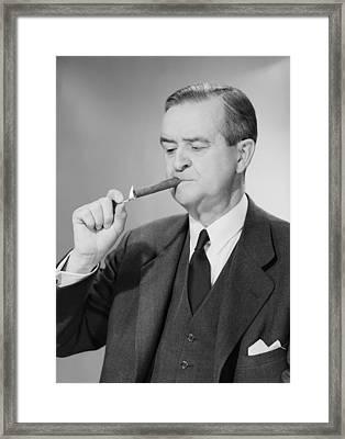 Mature Man Lighting Cigar Framed Print by George Marks