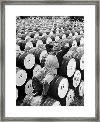 Mature Man Relaxing On Barrels (b&w) Framed Print