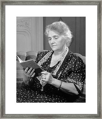 Mature Woman Reading Framed Print by George Marks