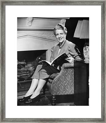 Mature Woman Sitting In Armchair, Holding Magazine, (b&w), Portrait Framed Print by George Marks