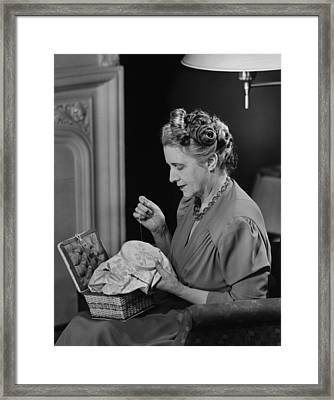 Mature Woman Sitting In Living Room, Doing Needlepoint, (b&w) Framed Print by George Marks