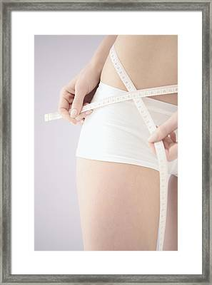 Measuring Waist Framed Print by Gavin Kingcome