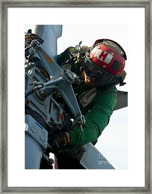 Mechanic Inspects An Mh-60r Sea Hawk Framed Print by Stocktrek Images