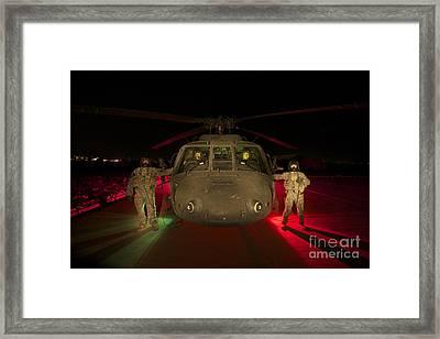 Medevac Crewmembers Stand Framed Print by Terry Moore
