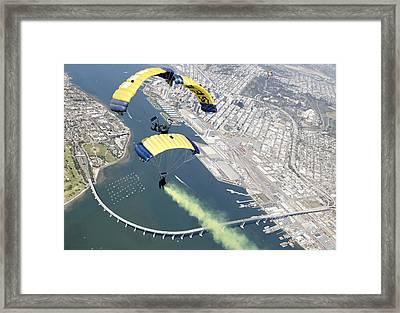 Members Of The U.s. Navy Parachute Team Framed Print by Stocktrek Images