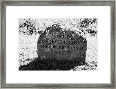 memorial stone for the dead english on Culloden moor battlefield site highlands scotland Framed Print by Joe Fox