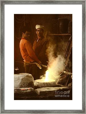 Men Pouring Bronze Framed Print by Ed Rooney