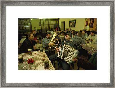 Men Sing Satirical Songs Of Austrias Framed Print by James L. Stanfield