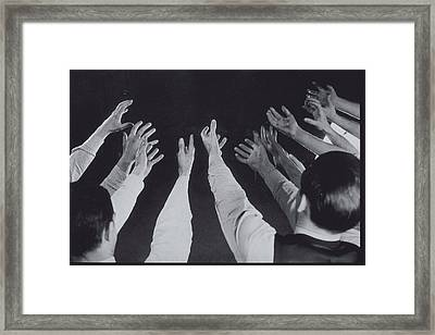 Mens Hands Reaching Out Into Blackness Framed Print