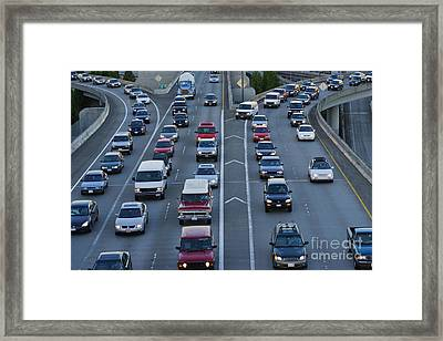 Merging Traffic Framed Print by Jeremy Woodhouse
