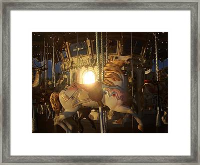 Merry Go Round At Sunset Framed Print by Steve Huang