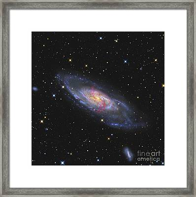 Messier 106, A Spiral Galaxy With An Framed Print by R Jay GaBany