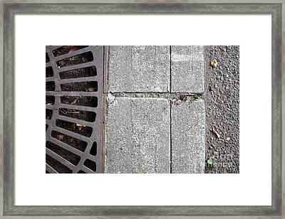 Metal Grate On Sidewalk Framed Print by Paul Edmondson