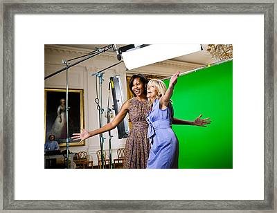 Michelle Obama And Jill Biden Joke Framed Print by Everett