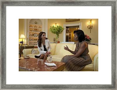 Michelle Obama And Queen Rania Framed Print by Everett
