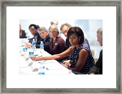 Michelle Obama Attends A Meeting Framed Print by Everett