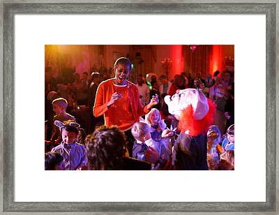 Michelle Obama Dancing With Children Framed Print by Everett
