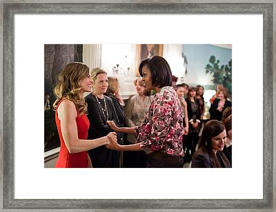 Michelle Obama Greets Actress Hilary Framed Print by Everett