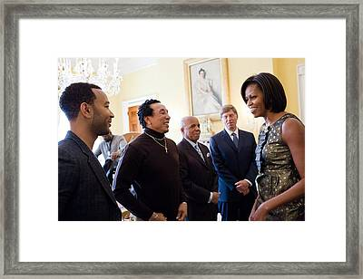 Michelle Obama Greets John Legend Framed Print by Everett